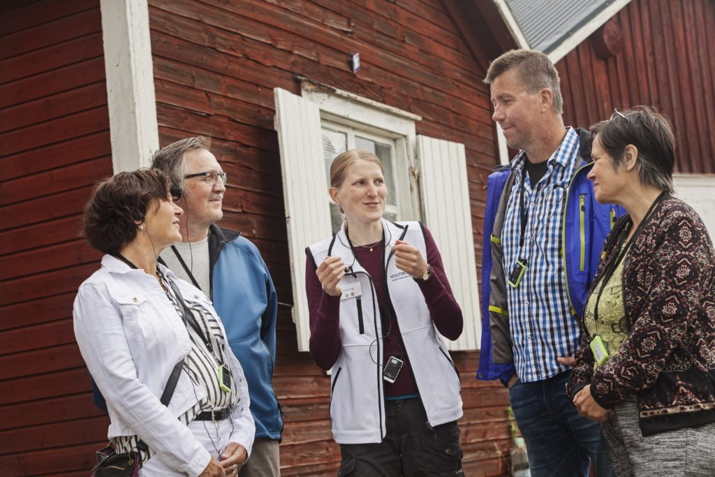Visitors on a guided tour in Gammelstad Church Town